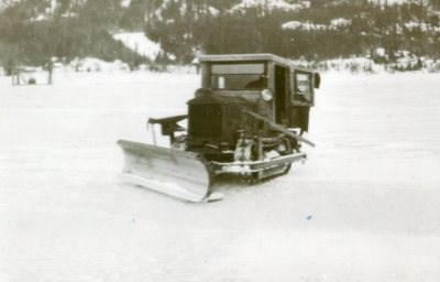 A Tractor Snowplow Crossing the Lake