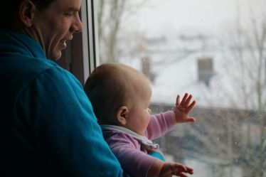 Mia Looking at Snow for the First Time