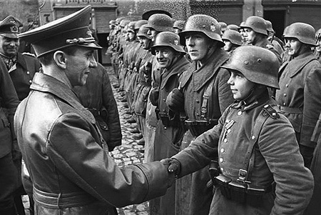 Goebbels congratulates a young recruit - Photo Credit: rarehistoricalphotos.com
