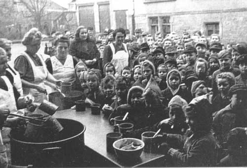 People Gathred around Soup Kitchens - Photo Credit: digada.de