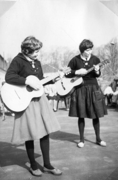 Jutta and another Girl Scout Playing the Guitar