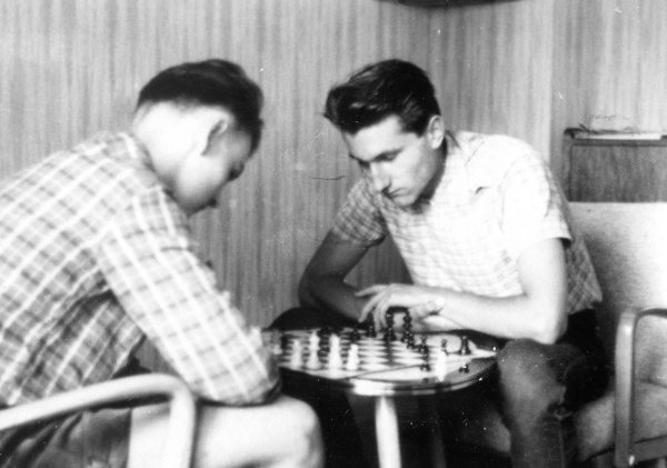 Peter with Spiked Haircut Playing Chess with a Friend