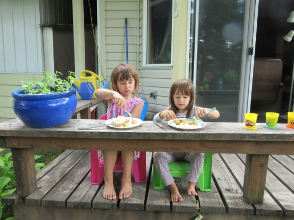 Azure and Emeline Eating a Snack on our Deck